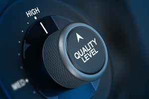 "Dial set to high with the words ""quality level"" on them, representing quality management systems."