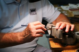 Midstate Mold staff working on maintenance and repair of tool part.